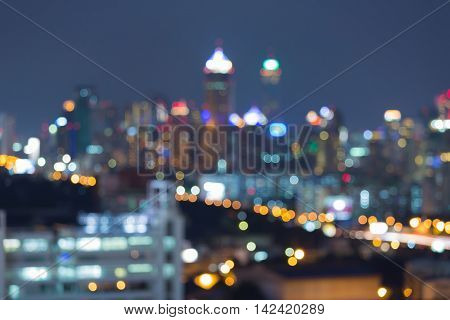 Abstract background, blurred bokeh lights office building nigh view