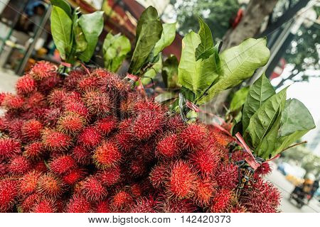 fresh rambutan fruit lychee fruit on market Jakarta. Indonesia