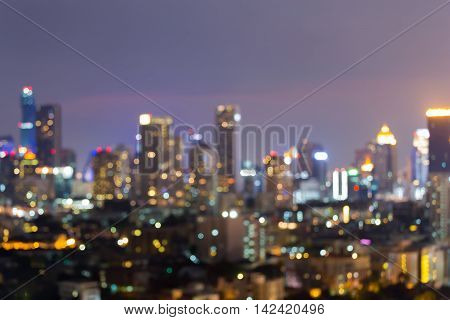 Blurred bokeh lights office building at night, abstract background