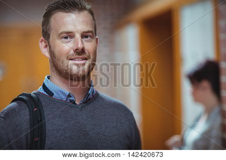 Portrait of mature student standing in the corridor