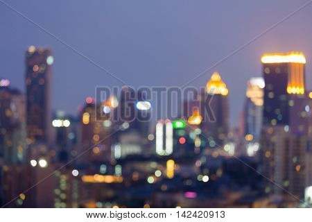 Blurred bokeh lights night view, city office building, abstract background