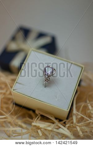 white gold ring with amethyst, in a beautiful package