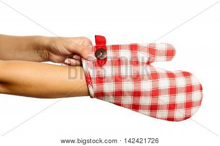 Red and white heat protective mitten on a female hands isolated on white background