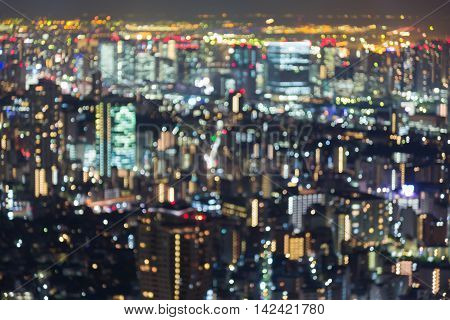 Blurred bokeh multiple colours lights Tokyo city downtown background
