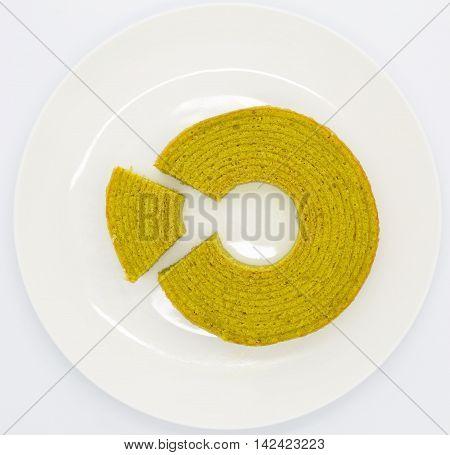 Green tea round layer cake on white plate