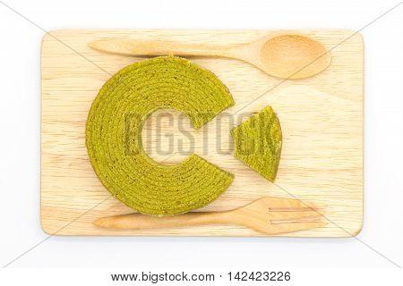 Masha round layer cake on wooden board, white background