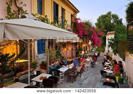 ATHENS, GREECE - AUGUST 08, 2016: People having drinks in the old town of Plaka on August 08, 2016.