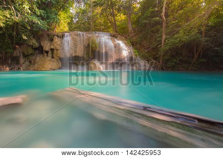 Deep forest blue stream waterfall, natural landscape background