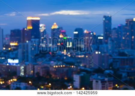 Blurred lights big city downtown at twilight, abstract background