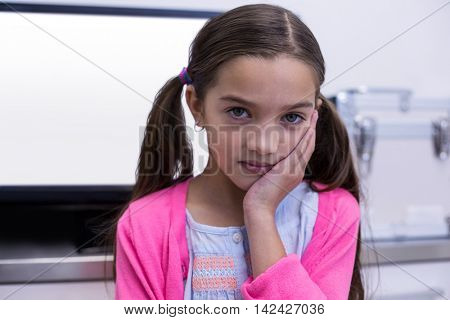 Unhappy young patient having a toothache in dental clinic