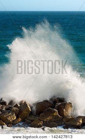 Spray and foam after big wave breaking on water break. Mediterranean Sea Liguria Italy