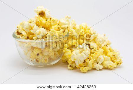 Sweet caramel popcorn on white background, isolated