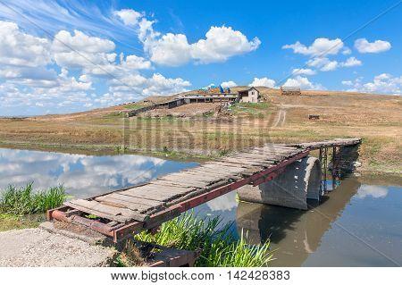 rural landscape and bridge over the river