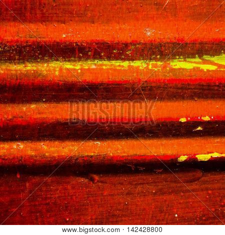 Textured dirty and worn red background with grooved yellow stripes in square format.