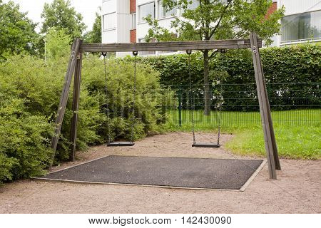 Swings On The Playground At Summer