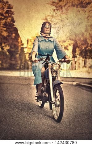 Retro dressed woman on a motorcycle