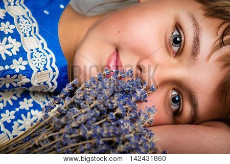 Portrait of a beautiful smiling teenage girl with a bouquet of flowers close up