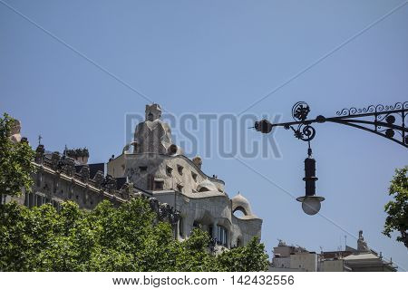 Barcelona, Spain - May 19, 2016: Casa Mila in Barcelona. This famous building was designed by the faboulos architect Antoni Gaudi, included in the list of UNESCO.