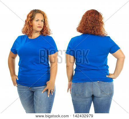 Photo of a woman posing with a blank blue t-shirt ready for your artwork or design.