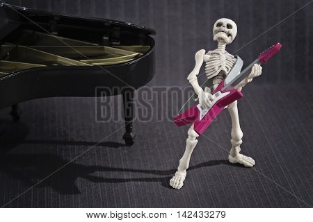 A Skeleton playing rock music with his electric guitar