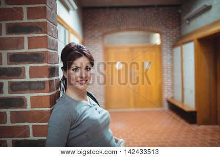 Portrait of mature student standing in the locker room at college
