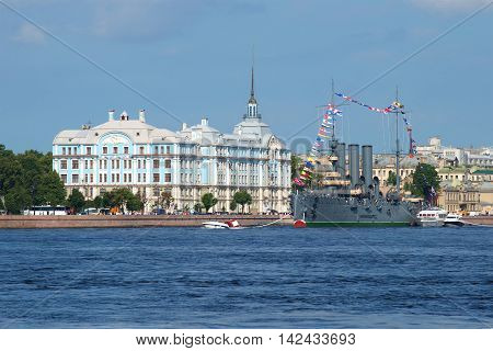 ST. PETERSBURG, RUSSIA - JULY 28, 2016: A view of the Nakhimov naval Academy and the cruiser