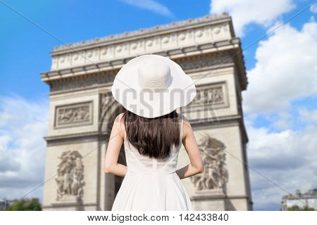 young woman wear dress and behind you with Arc de Triomphe