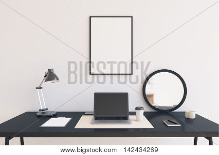 Modern workspace at home office. Laptop in center of table. Lamp and mirror by its sides. Large poster in frame on white wall. Concept of work at home. 3D rendering. Mock up. Close up