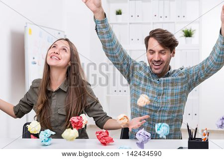 Man And Woman With Paper Balls.