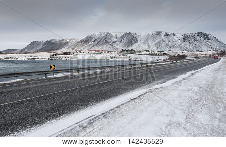 Frozen road leading to the snowy mountains at Selfoss town in Iceland