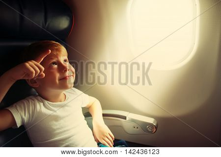 Cute Happy Little Boy Sit Airplane Window Light Travel Holiday Toned