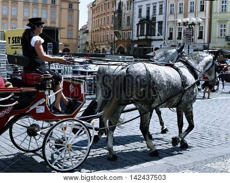PRAGUE, CZECH REPUBLIC - JUNE 16, 2016: The crew carriage pulled by horses on the Prague street