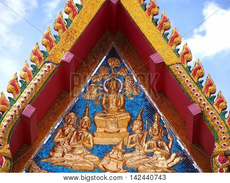 Golden Buddha and angel on gable chapel