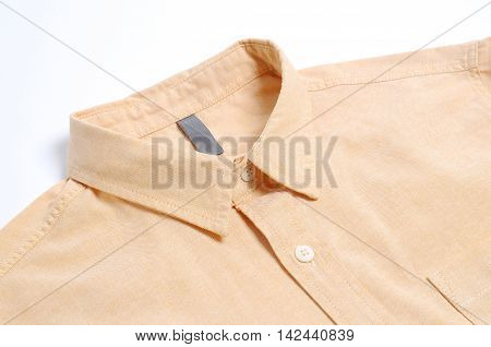 Yellow plain cotton male shirt White background.