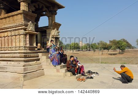 KHAJURAHO, INDIA - DEC 24, 2015: Big family with children making photo at famous touristic site - historical hindu temples of Khajuraho on December 24, 2015. Khajuraho Monuments built between 950 and 1150.