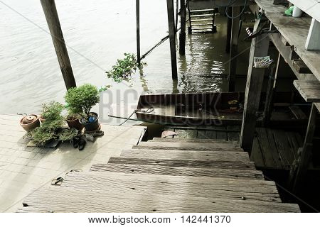 Wooden stairs at the riverside country community located Thailand