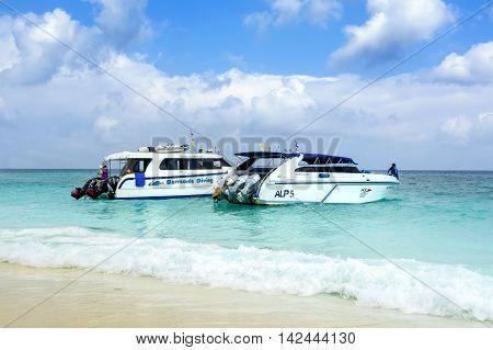 MALDIVES ISLAND  - SEPTEMBER 11, 2015: Boats on the tropical beach, Maldives September 11, 2015