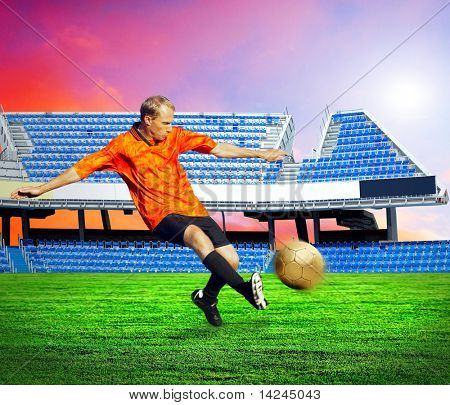 Happiness football player after goal on the field of stadium under sky