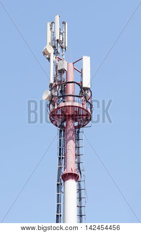 Mobile phone communication repeater antenna tower in blue sky