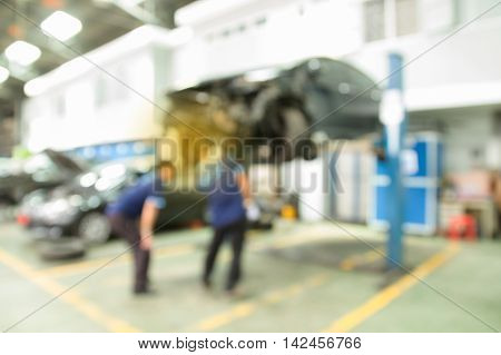 Working Car Mechanic Inspection  Of Accident In Garage.