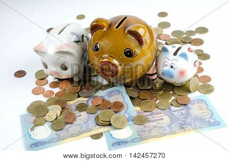 piggy bank and coin, isolate image on whit background