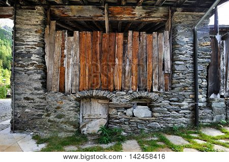 rustic alpien facade of barn in Rhemes Notre Dame