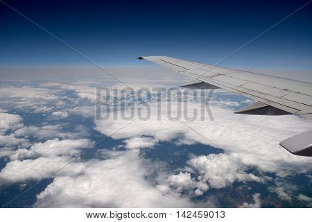 Commercial airliner at 30000 feet above the clouds