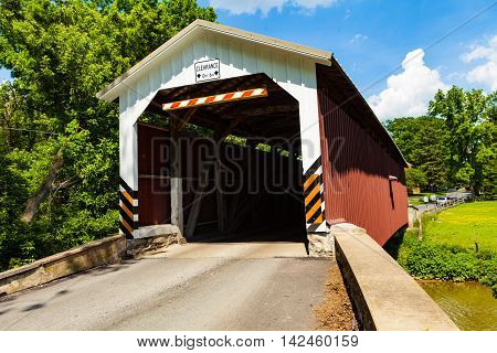 Strasburg PA - June 8 2012: The Lime Valley Covered Bridge or Strasburg Bridge spans the Pequea Creek in Lancaster County PA.