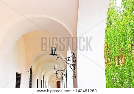 Colonnaded corridor and candlesticks in Palanok Castle or Mukachevo Castle, Zakarpattya, Ukraine, built in 14th century
