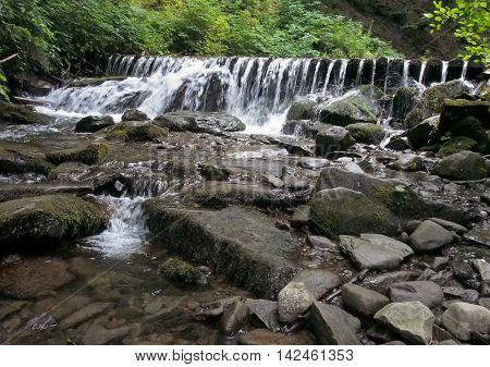 Rough mountain river with thresholds and falls in the Ukrainian Carpathians