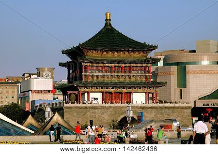 Xi'an China - September 8 2006: C.1384 Bell Tower rises 30 meters high at the center of Ginwa Plaza