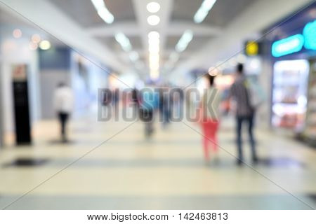 Blurred background of airport shops and corridor
