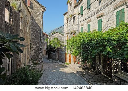 Typical narrow street in town of Risan Montenegro