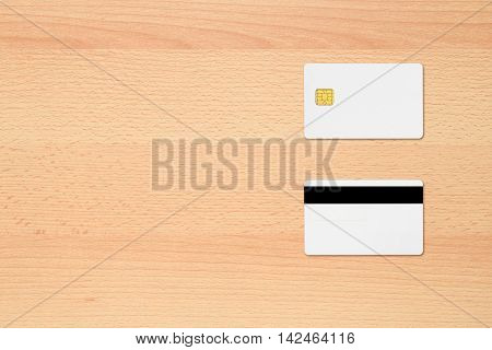 Blank credit cards on office desk top view